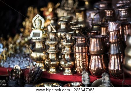 Brass utensils shop with handicrafts and souvenirs in Kathmandu market, Nepal