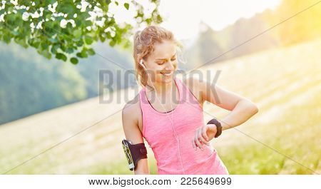 Woman jogging with wearable smartwatch and mp3 player