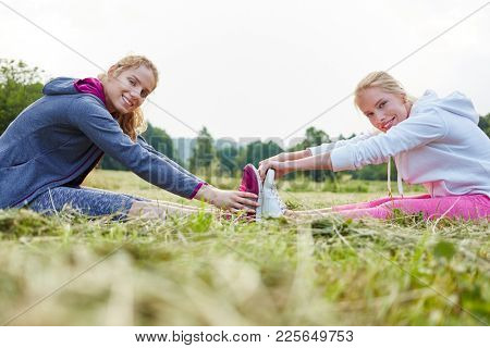 Young women stretching for healthy bodies in the nature