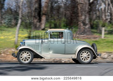 Adelaide, Australia - September 25, 2016: Vintage 1929 Nash Coupe driving on country roads near the town of Birdwood, South Australia.
