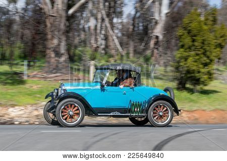 Adelaide, Australia - September 25, 2016: Vintage 1928 Whippet 96 Roadster driving on country roads near the town of Birdwood, South Australia.