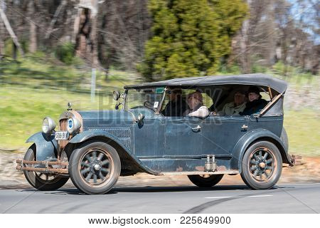 Adelaide, Australia - September 25, 2016: Vintage 1929 Essex Super Six Tourer driving on country roads near the town of Birdwood, South Australia.