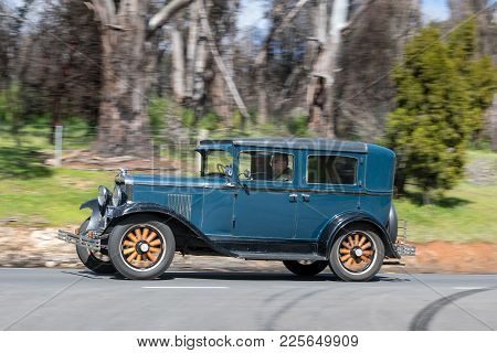 Adelaide, Australia - September 25, 2016: Vintage 1929 Chevrolet AC International Sedan driving on country roads near the town of Birdwood, South Australia.