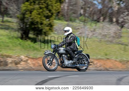Adelaide, Australia - September 25, 2016: Vintage 1951 Triumph Tiger 100 Motorcycle on country roads near the town of Birdwood, South Australia.