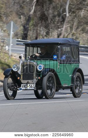 Adelaide, Australia - September 25, 2016: Vintage 1927 Austin 7 Chummy Tourer driving on country roads near the town of Birdwood, South Australia.