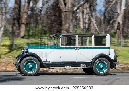 Adelaide, Australia - September 25, 2016: Vintage 1926 Paige Sedan driving on country roads near the town of Birdwood, South Australia.