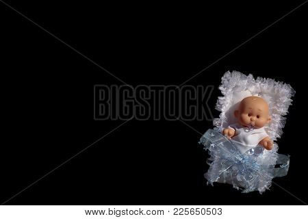 Baby Doll In White Diapers And Glass Pacifier Pacifier On Black Background