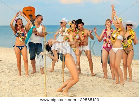 Vacationers have fun doing the limbo