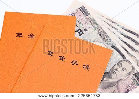 Kagawa, Japan - January 22: Japanese National Pension Plan Handbook And Money On White Background
