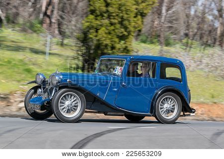 Adelaide, Australia - September 25, 2016: Vintage 1934 Wolseley Hornet Special Sports Saloon Driving