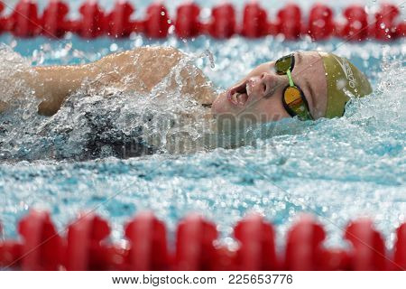 ST. PETERSBURG, RUSSIA - DECEMBER 22, 2017: Unidentified athlete in women backstroke swimming competitions during Salnikov Cup. The Cup is recognized as a preliminary of World Swimming Championship