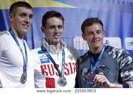 ST. PETERSBURG, RUSSIA - DECEMBER 22, 2017: Winners of XI Salnikov Cup in 50 m breaststroke swimming Kirill Prigoda, Russia (center), Ilya Shymanovich, Belarus (left) and Oleg Kostin, Russia