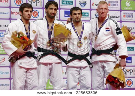 ST. PETERSBURG, RUSSIA - DECEMBER 17, 2017: Winners in Men U81 during award ceremony of Judo World Masters 2017. Left to right: Lappinagov, Khalmurzaev, Khubetsov, De Wit
