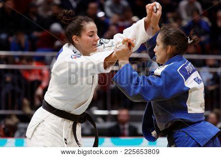 ST. PETERSBURG, RUSSIA - DECEMBER 17, 2017: Final fight Maria Portela, Brazil (blue) vs Barbara Matic, Croatia during Judo World Masters tour. Portela won gold medal