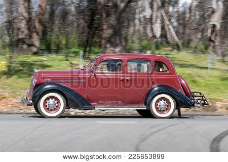 Adelaide, Australia - September 25, 2016: Vintage 1936 Plymouth Business Sedan Driving On Country Ro