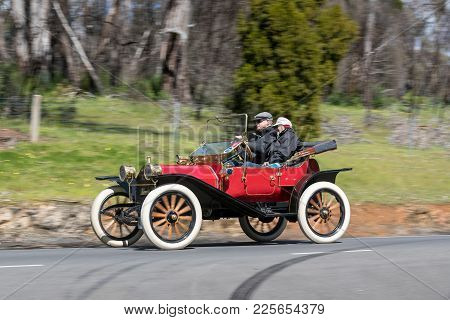 Adelaide, Australia - September 25, 2016: Vintage 1913 Hupmobile 20 Runabout Driving On Country Road