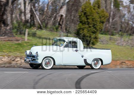 Adelaide, Australia - September 25, 2016: Vintage 1956 Holden Fj Utility Driving On Country Roads Ne