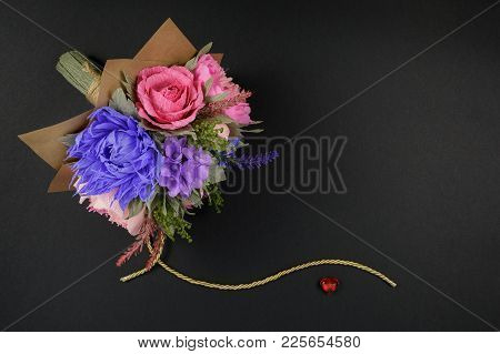 A Bouquet Of Colorful Paper Flowers And A Small Red Heart On A Black Background As A Backdrop For A