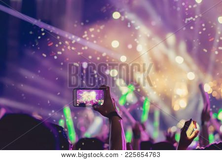 Crowd Holding Smartphone At Concert Stage Lights And People Fan Audience Silhouette Raising Hands In