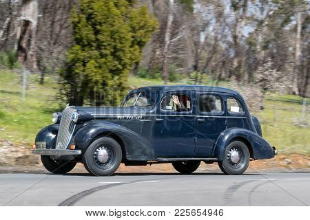 Adelaide, Australia - September 25, 2016: Vintage 1936 Oldsmobile Fr Sedan Driving On Country Roads