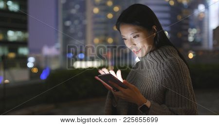Woman use of smart phone at night