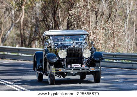 Adelaide, Australia - September 25, 2016: Vintage 1929 Packard 633 Roadster Driving On Country Roads
