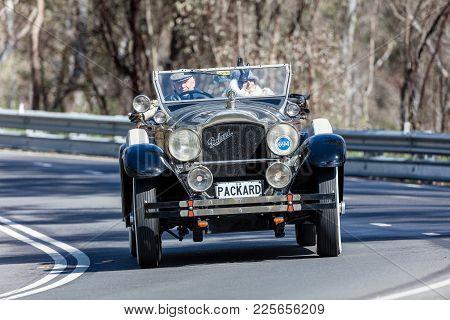 Adelaide, Australia - September 25, 2016: Vintage 1929 Packard 640 Roadster Driving On Country Roads