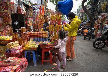 Hanoi, Vietnam - Jan 26, 2017: People Take A Walk Buying Decoration And Flower For Vietnamese Lunar