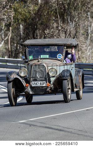 Adelaide, Australia - September 25, 2016: Vintage 1926 Willys Overland 96 Doctors Roadster Driving O