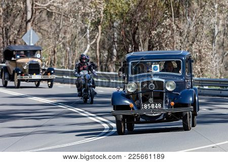 Adelaide, Australia - September 25, 2016: Vintage 1934 Morris Cowley Six Saloon Driving On Country R