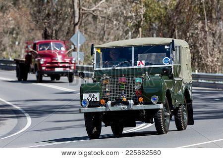 Adelaide, Australia - September 25, 2016: Vintage 1949 Landrover Series I 80 Utility Driving On Coun