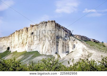 Mountain  White Frome  Limestone In Crimea With Caves  Blue Sky And Green Near  Mountains