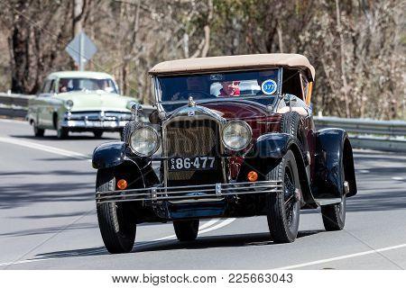 Adelaide, Australia - September 25, 2016: Vintage 1927 Buick Sports Roadster Convertible Driving On