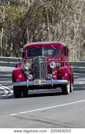 Adelaide, Australia - September 25, 2016: Vintage 1936 Chrysler C8 Sedan Driving On Country Roads Ne