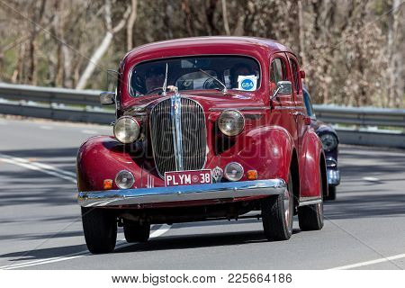 Adelaide, Australia - September 25, 2016: Vintage 1938 Plymouth Driving On Country Roads Near The To