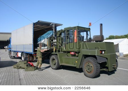 Big Military Forklift Loading A Truck