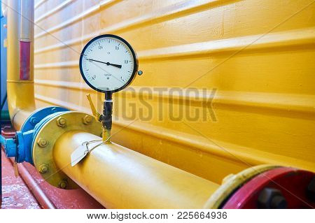 The Gauge On The Yellow Gas Pipe Shows The Pressure.