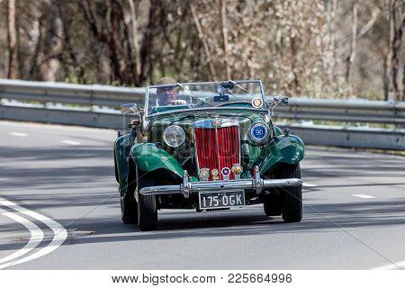 Adelaide, Australia - September 25, 2016: Vintage 1951 Mg Td Roadster Driving On Country Roads Near