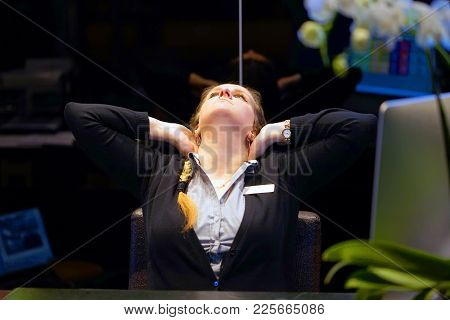 Tired Neck. Hotel Manager. A Woman-reception Suffering From Neck Pain. Female Feeling Tired, Exhaust