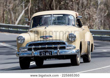 Adelaide, Australia - September 25, 2016: Vintage 1957 Chevrolet Utility Driving On Country Roads Ne