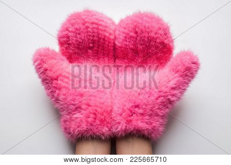 Fluffy Mittens. Close Up Part Of Woman Hands In Fluffy Pink Mittens Against White Background