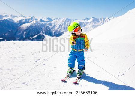 Kids Winter Snow Sport. Children Ski. Family Skiing.