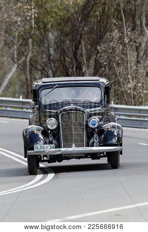 Adelaide, Australia - September 25, 2016: Vintage 1934 Oldsmobile Sedan Driving On Country Roads Nea