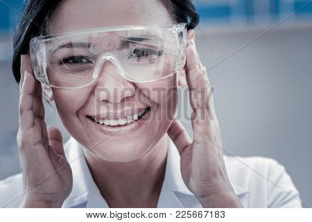 Positive Attitude To Work. Close Up Portrait Of A Cheerful Female Researcher Grinning Broadly While