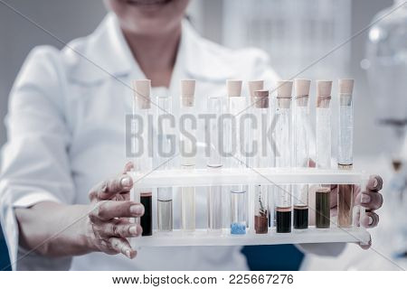 Experimental Approach. Scaled Up Look On Hands Of A Female Scientist Working In A Lab And Holding A