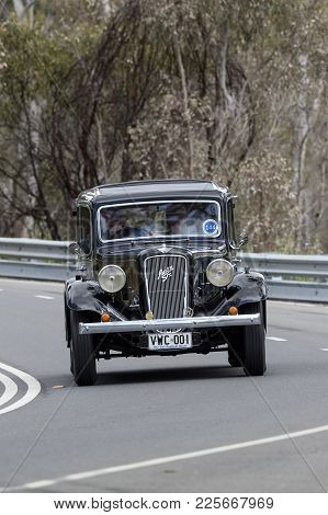 Adelaide, Australia - September 25, 2016: Vintage 1936 Austin 18 York Sedan Driving On Country Roads