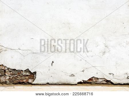 Brick Wall With Crashed White Plaster And Sidewalk. White Concrete Wall Texture For Abstract Backgro
