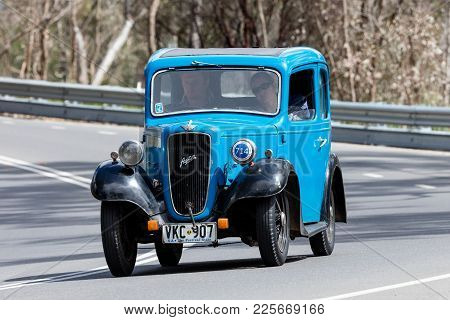 Adelaide, Australia - September 25, 2016: Vintage 1937 Austin 7 Ruby Saloon Driving On Country Roads