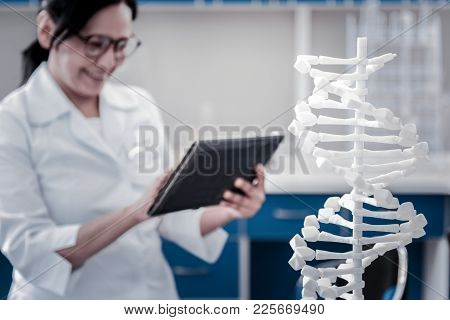 Healthcare Research. Selective Focus On A Three Dimensional Model Of Dna Standing In A Lab With A Sm