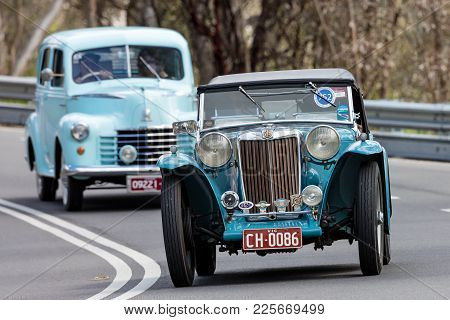 Adelaide, Australia - September 25, 2016: Vintage 1939 Mg Tb Sports Roadster Driving On Country Road